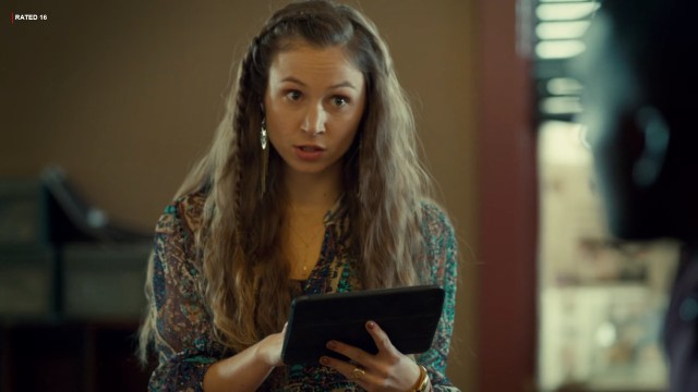 Waverly holding a tablet.
